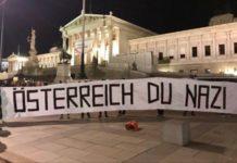 Linkes Demo-Banner vor dem Parlament am Dr.-Karl-Renner-Ring in Wien.